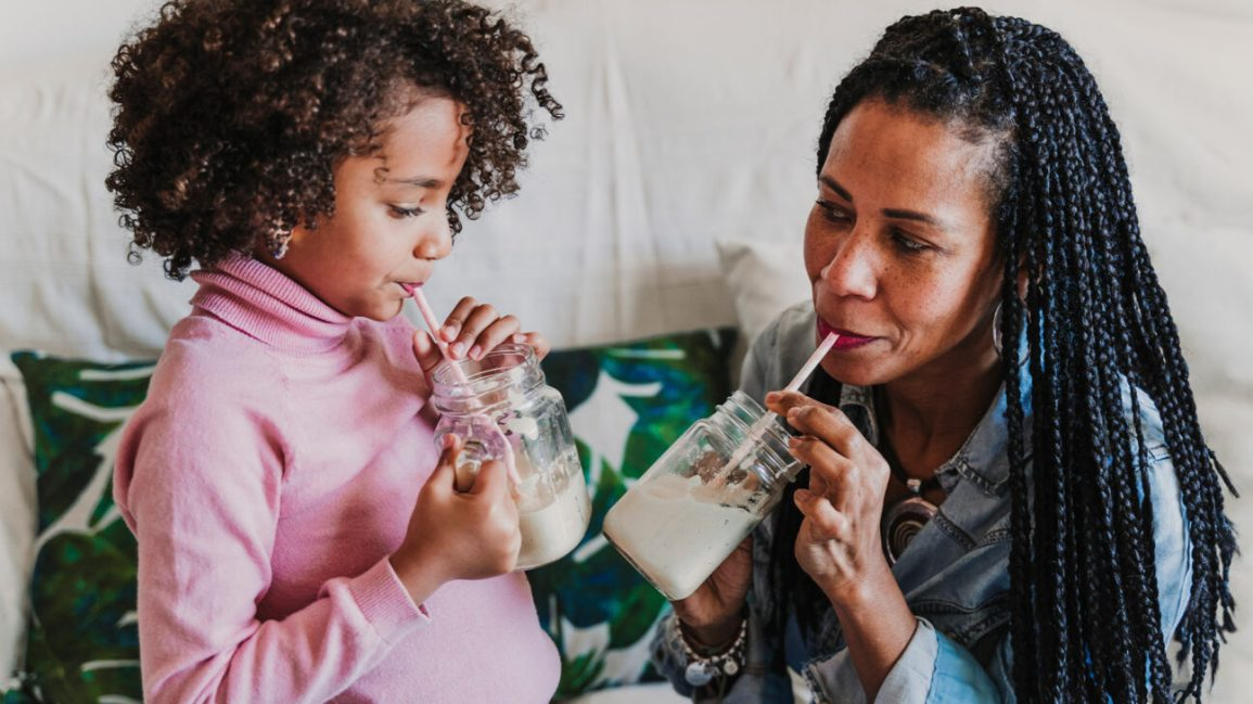 Mother and daughter drinking protein shakes