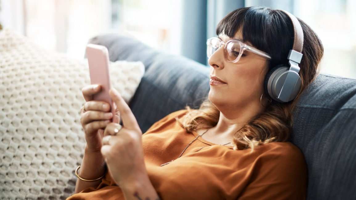 Woman with glasses wearing headphones