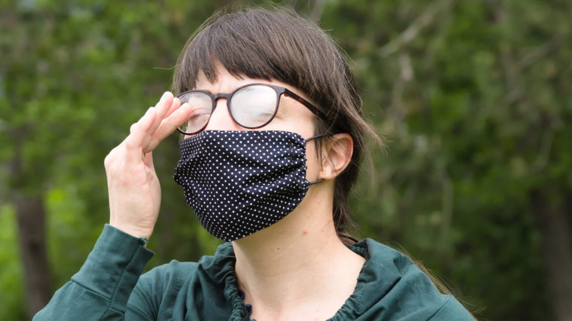 How to stop glasses from fogging, woman wearing facial covering and foggy glasses