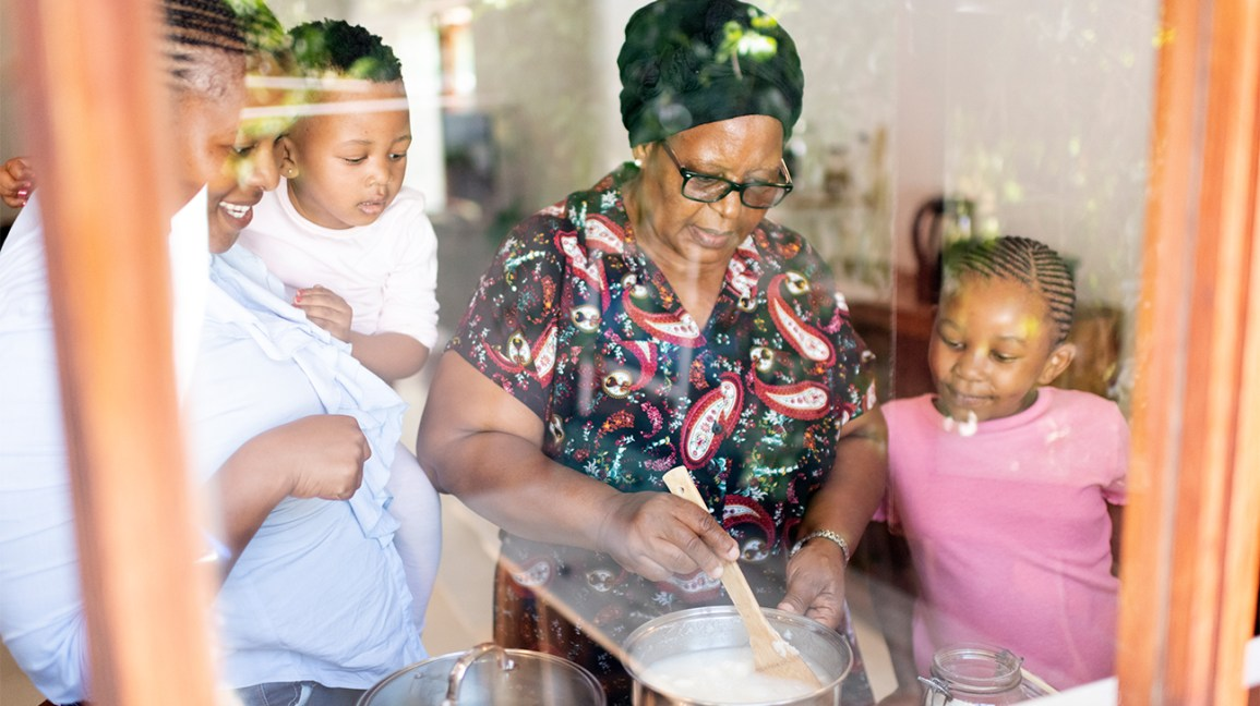 Black family cooking with grandmother