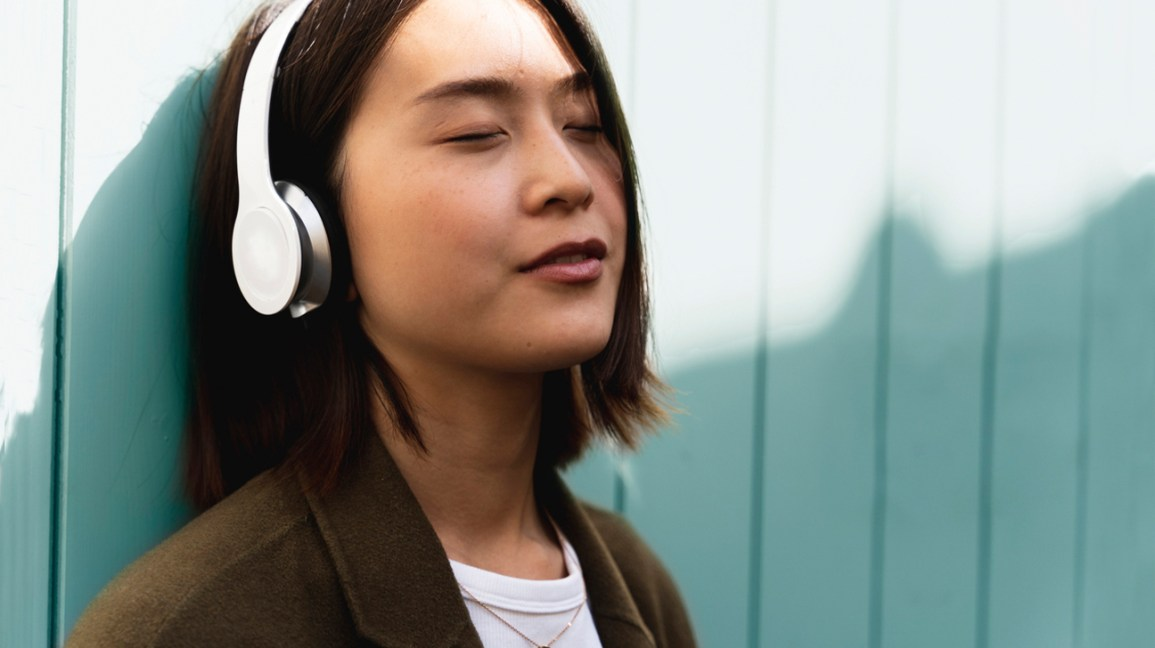 woman with headphones on and eyes closed