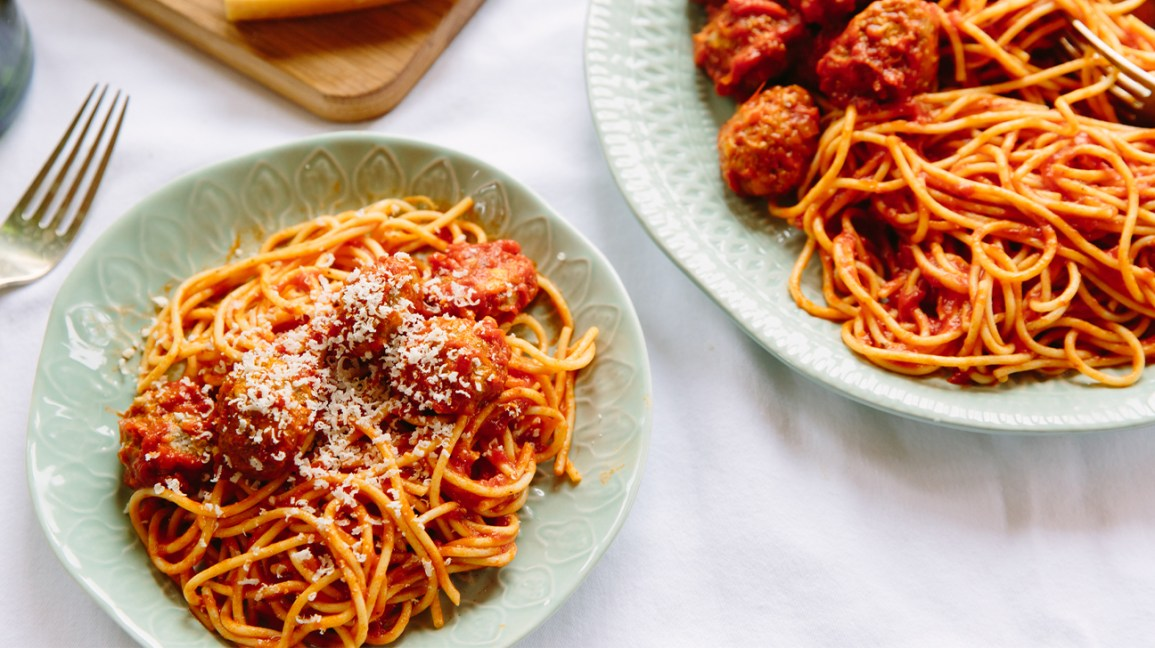 Spaghetti and meatballs in tomato sauce on a dinner plate