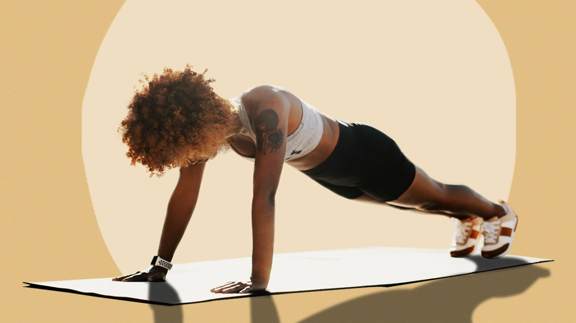 woman doing plank in workout clothes