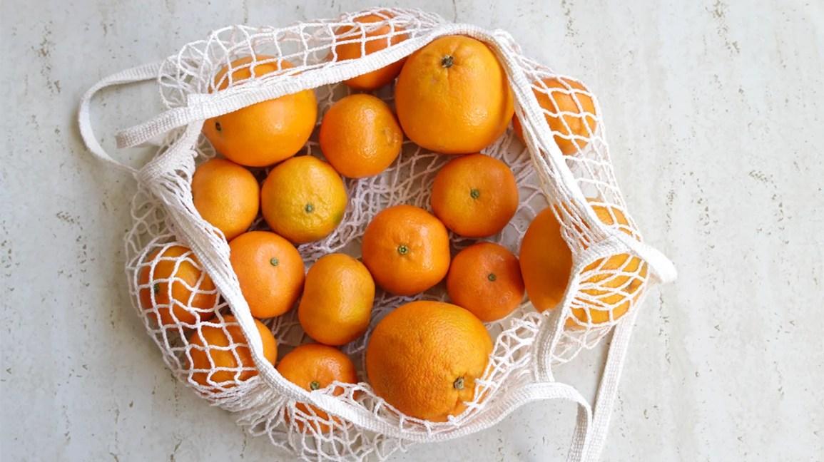 fresh oranges in a bag