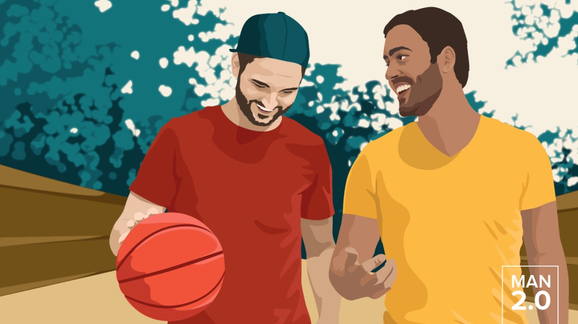 Two guys laughing playing basketball