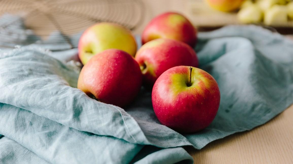 whole apples on a napkin