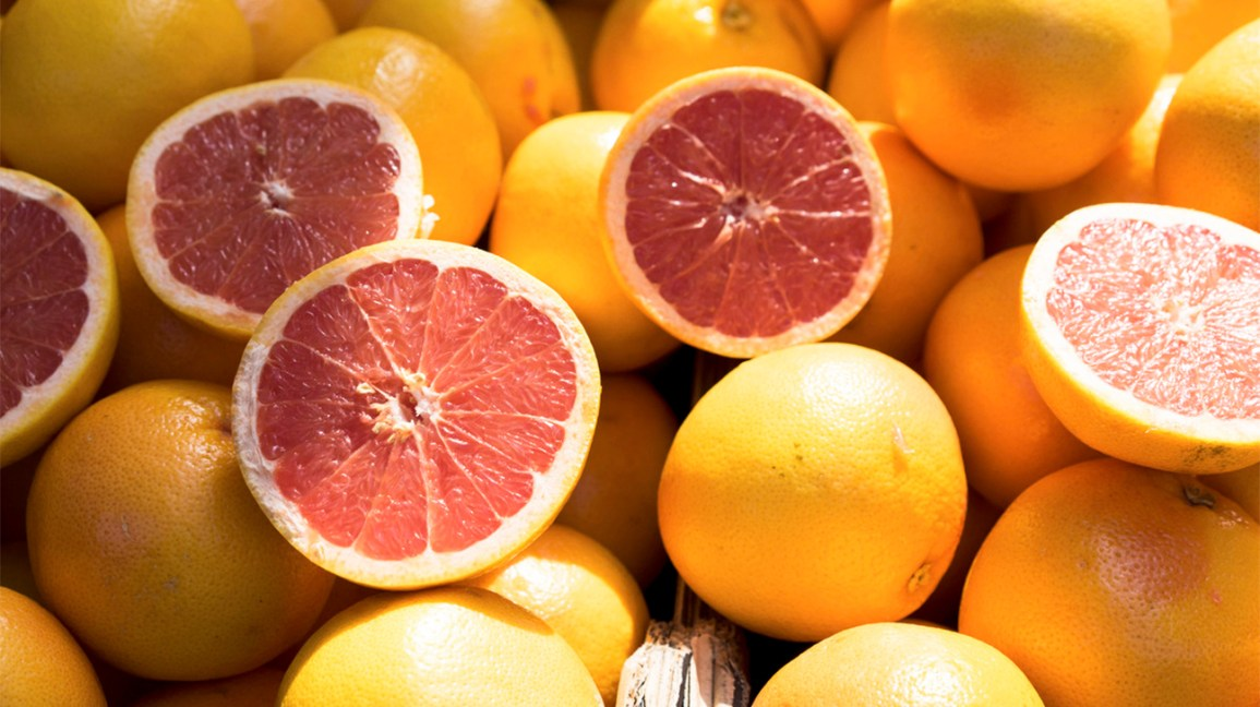 grapefruit halves and whole grapefruits