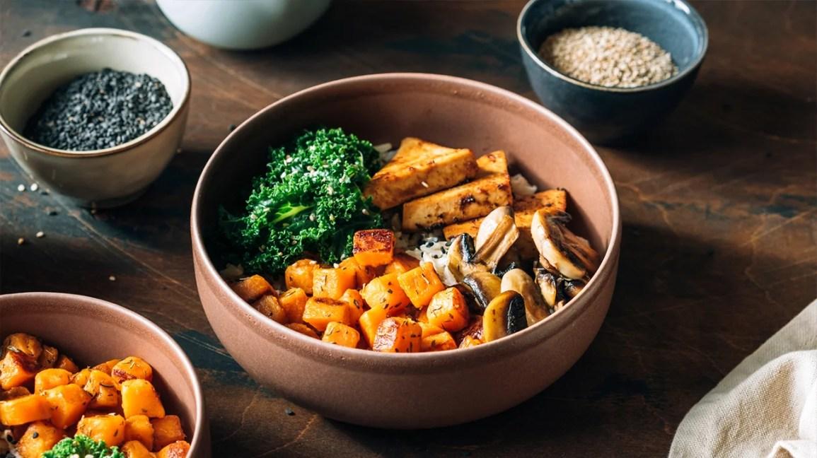 a bowl of tofu, greens, sweet potatoes, rice, and mushrooms