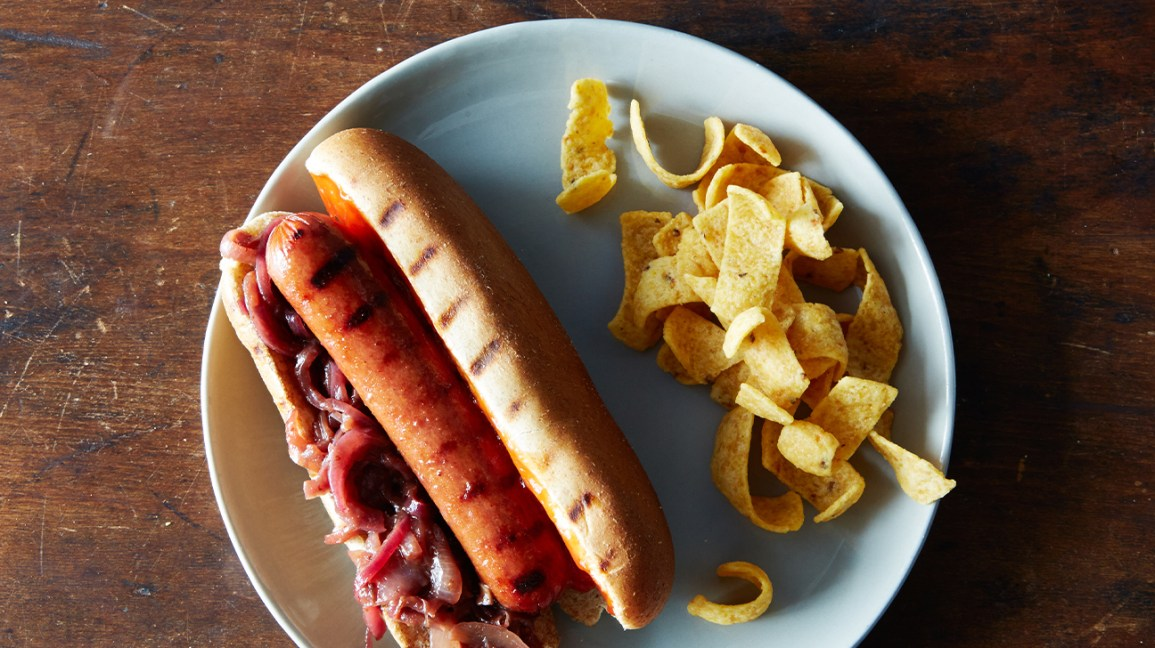 hot dog with onions and corn chips