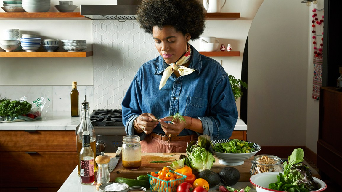 woman making salad with fresh vegetables