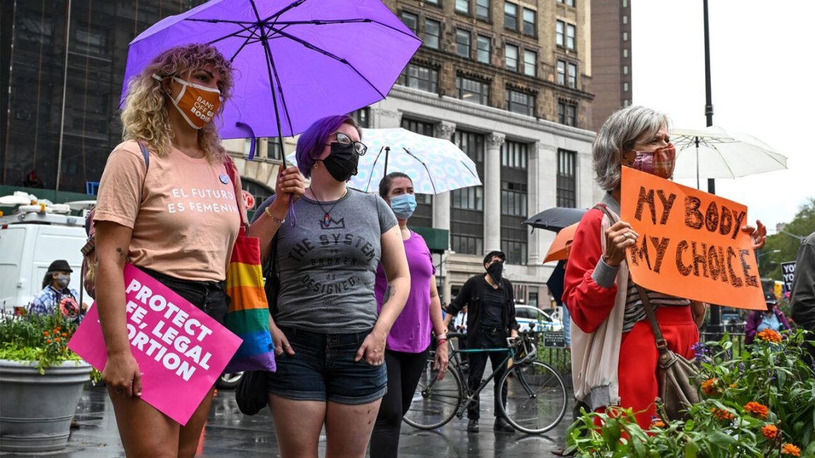 This image has an empty alt attribute; its file name is Females_Protest_Signs_1296x728-header-1-1296x729.jpg