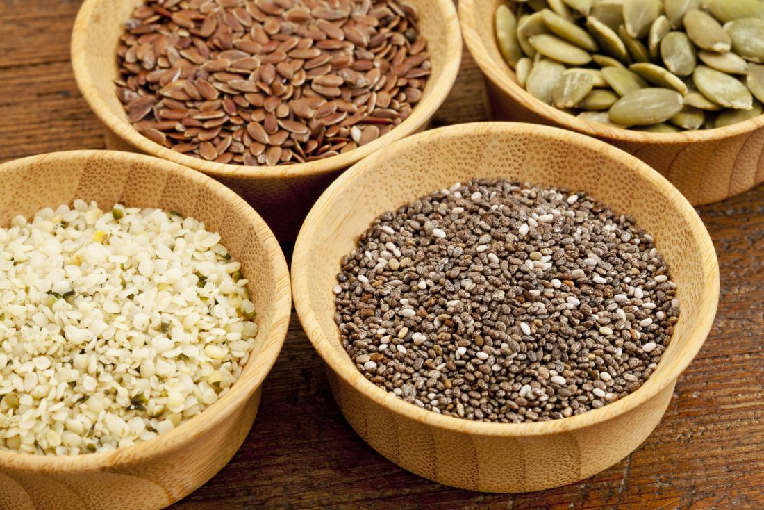 Seeds in wooden bowls