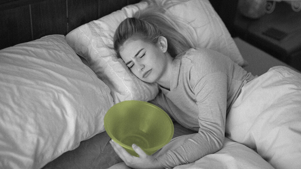 A woman sick in bed wonders Do I have a stomach virus or food poisoning?