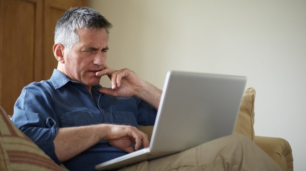 a man watching porn on his computer as he has an addiction to it