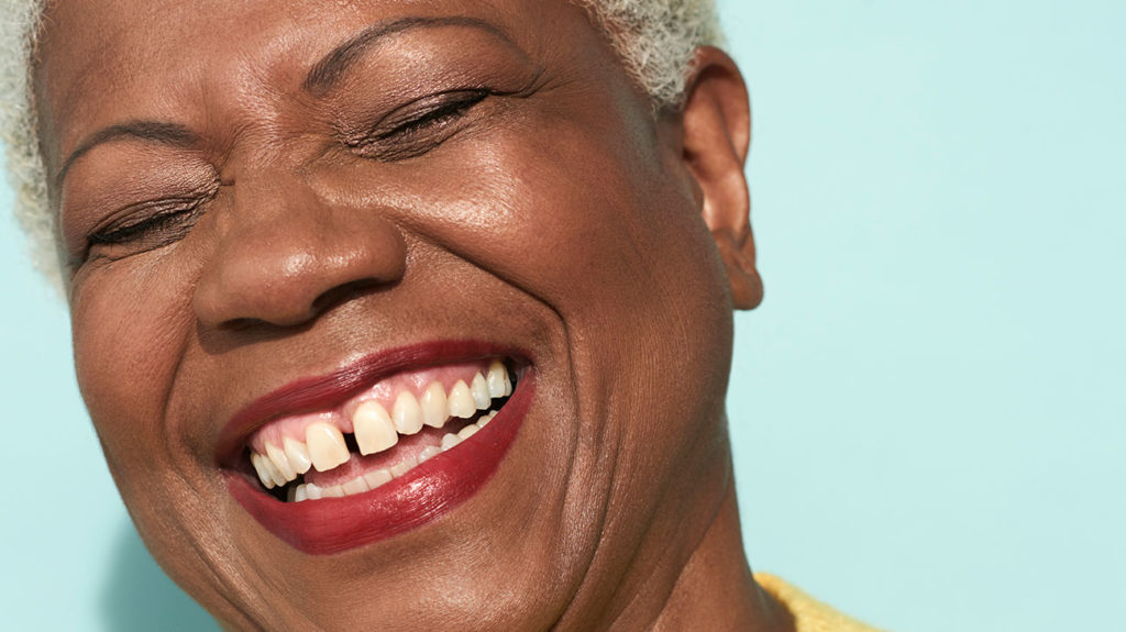a smiling woman with a diastema
