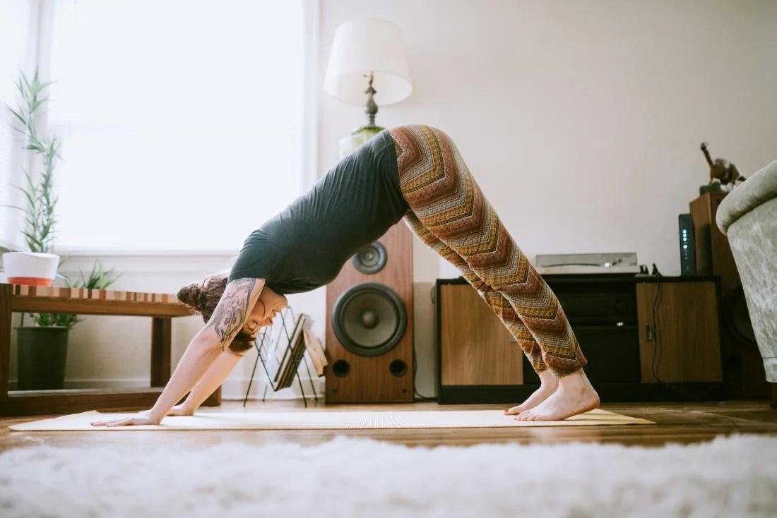 Girl doing yoga at home