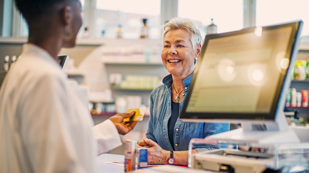 a woman talking to a pharmacist about what does medicare part d cover