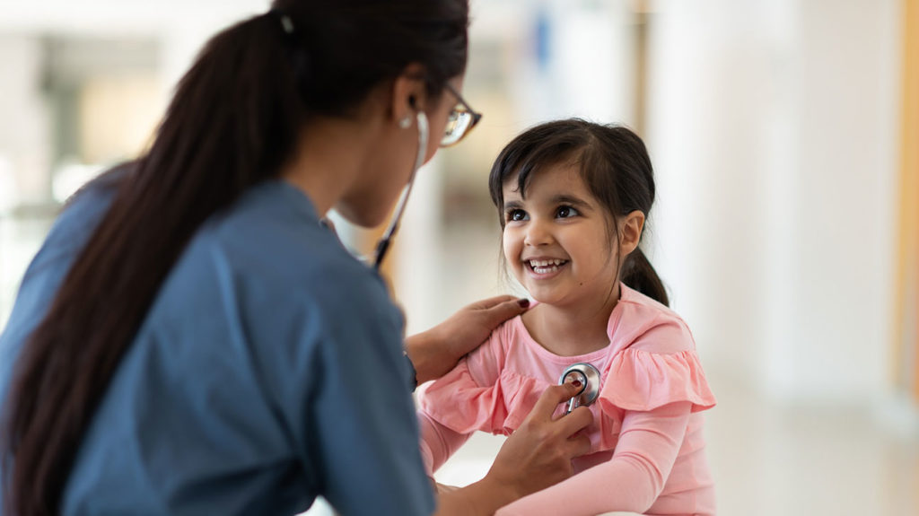 a doctor checking pediatric vital signs on a child