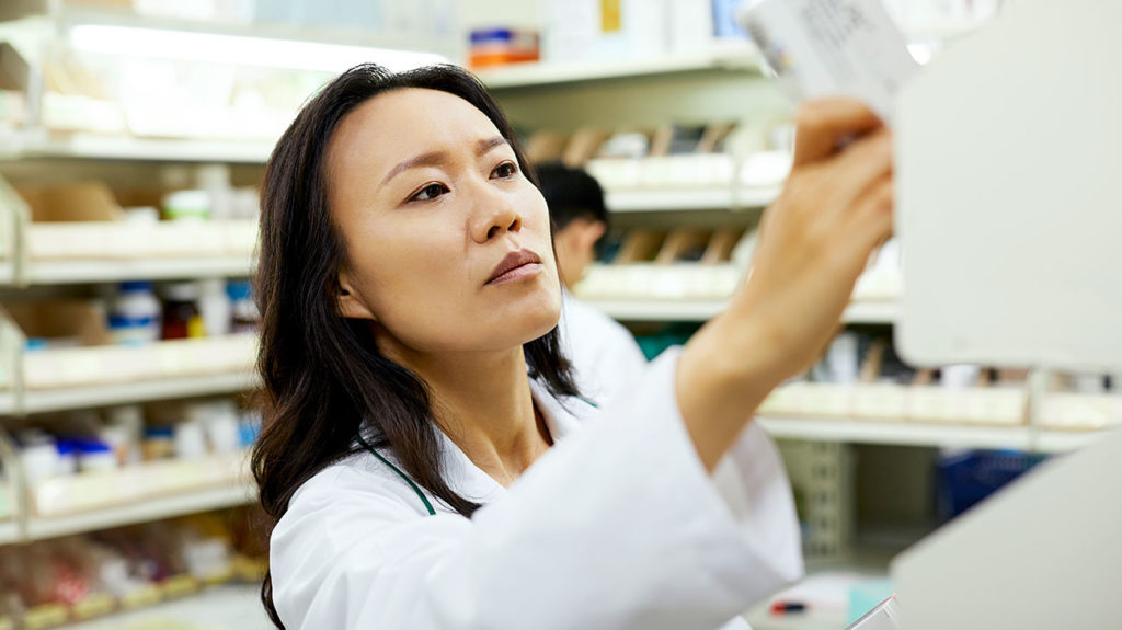a pharmacist picking out behind the counter treatment for Ankylosing Spondylitis