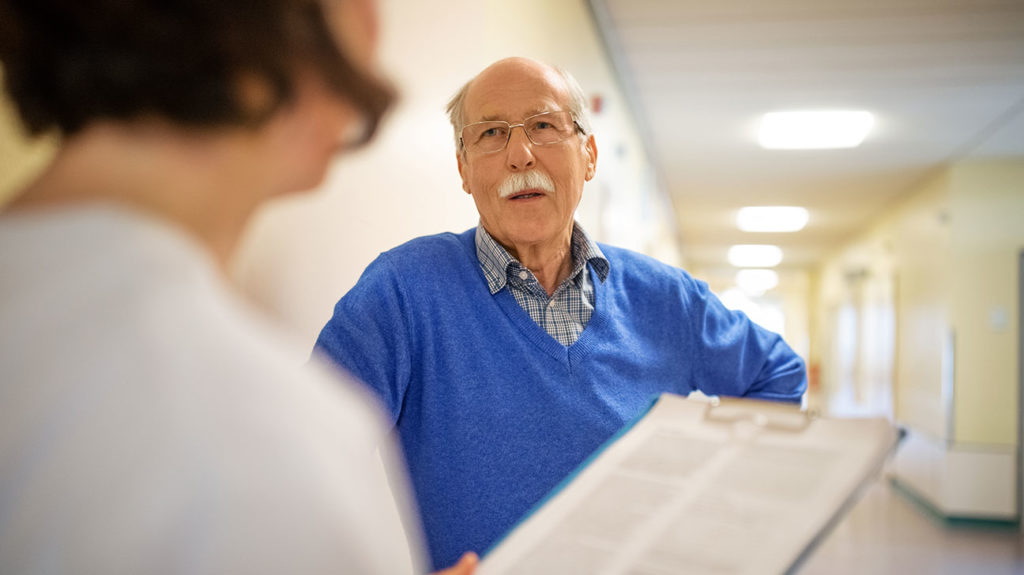 a man talking to a healthcare professional about what is covered by medicare part c