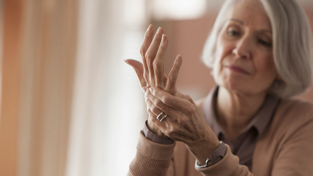 a woman with pain in her hand due to Small fiber neuropathy