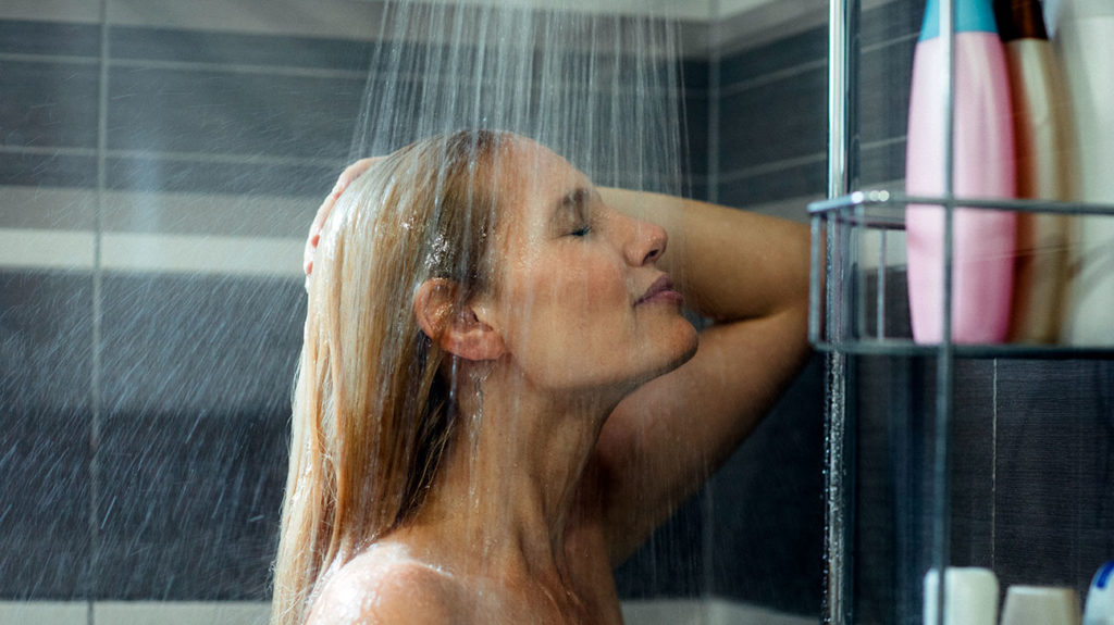a woman in the shower and wondering how to clean your vagina