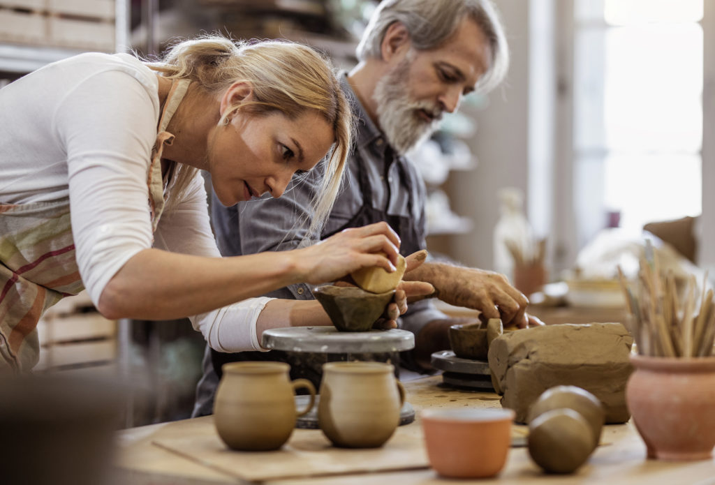 Man and woman at pottery class