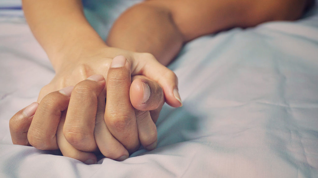 hands being held in bed