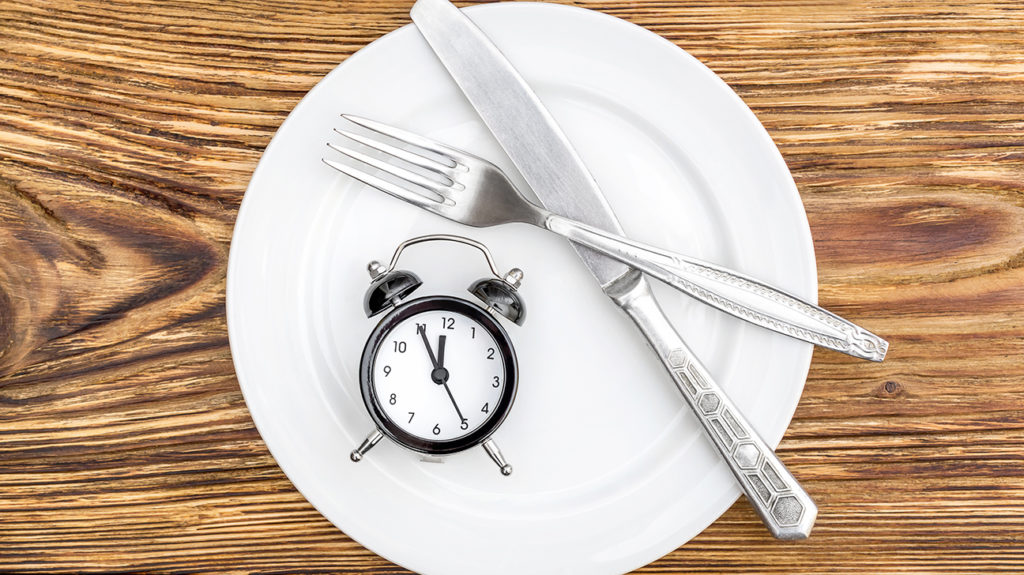 Knife, fork, and a clock on a plate