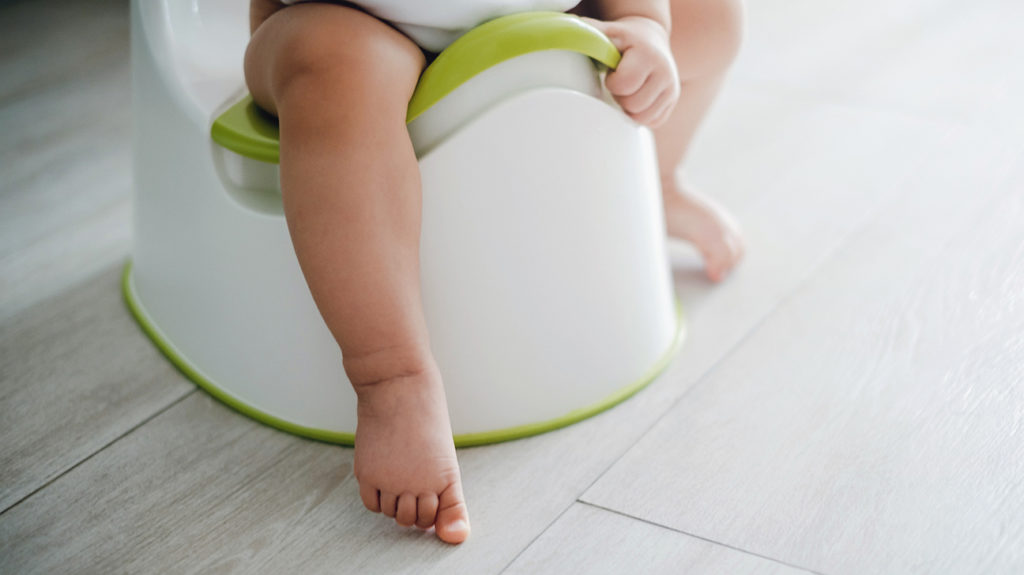 a child sat on a potty where the mother might wonder What happens if you eat poop