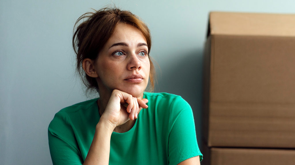 a woman looking pensive as she wonders if she has withdrawal bleeding