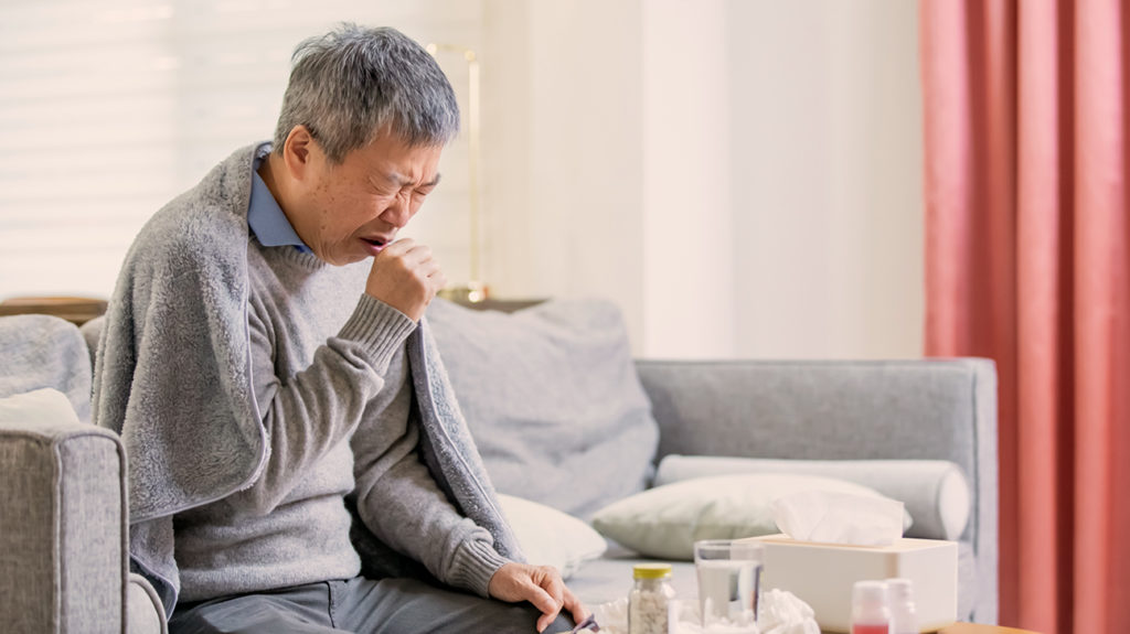 a man coughing due to chronic bronchitis