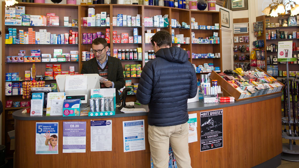 a man buying a-fib meds in a pharmacy