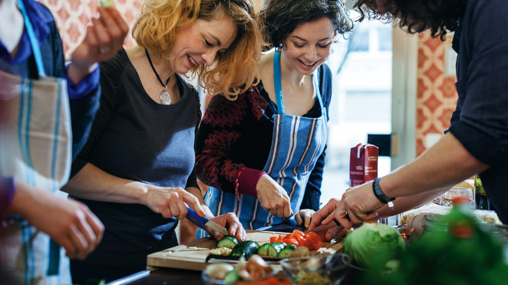 woman at a cooking class where they are learning How to follow a healthful diet