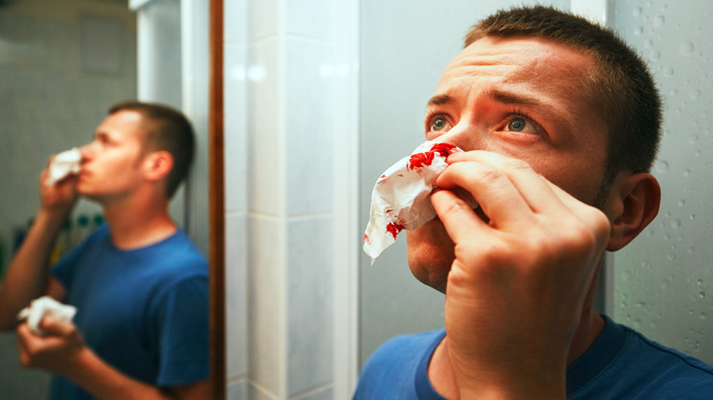 a man with a nose bleed which he has everyday
