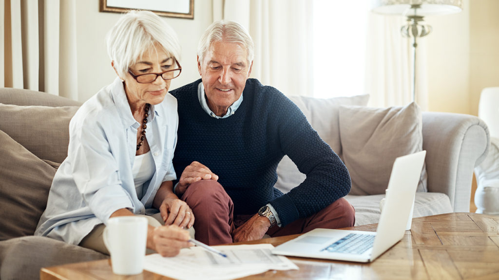 a couple looking at paperwork and wondering How are PPO and HMO Medicare different?