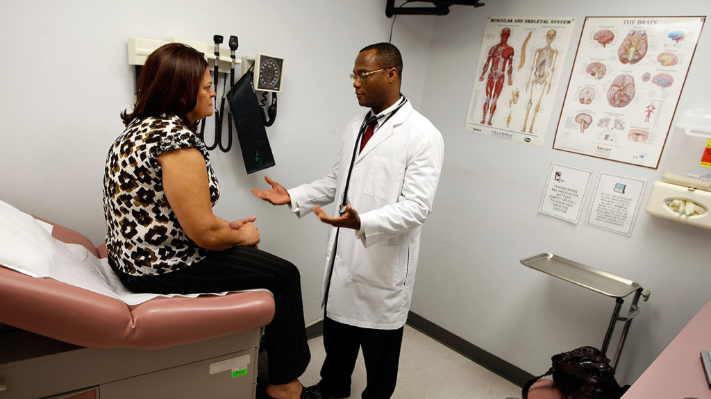 a woman talking to a doctor about whether she has a bacterial vaginosis or  yeast infection