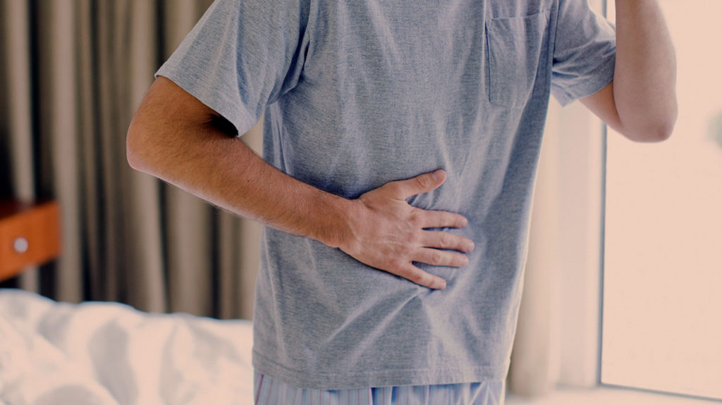 a man with a sore stomach due to viral hepatitis