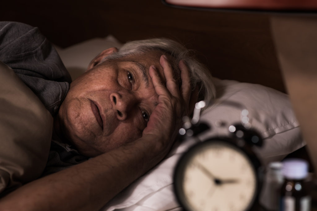 older person struggling to sleep
