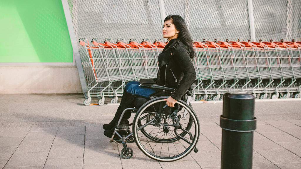a young woman in a wheelchair who has eligibility for medicare because of her disability