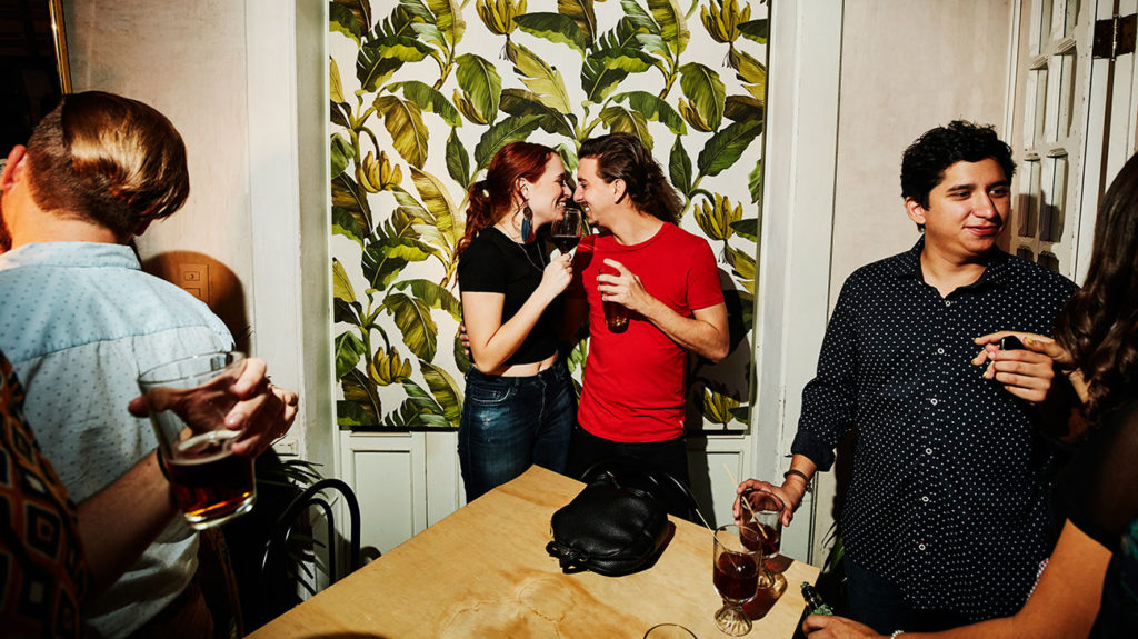A woman and a man drink alcohol at a party, which can impact sex or sexual behavior.