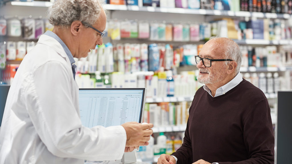 a man collecting methotrexate from a pharmacist that he is taking to treat  psoriatic arthritis