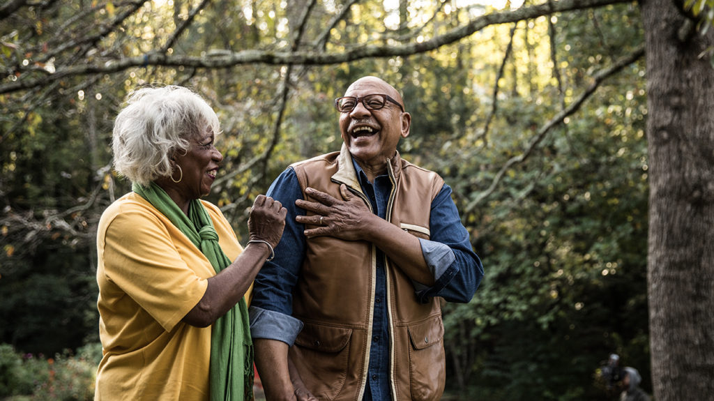 a senior couple walking in the woods and laughing about what is the best medicare plan for seniors
