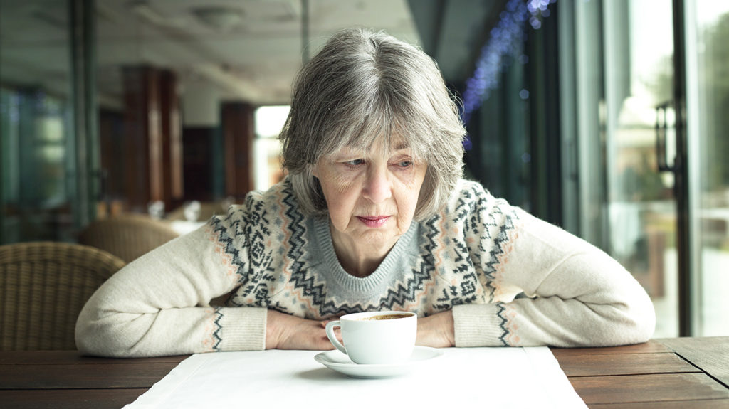 anxious woman in a restaurant with sensory overload