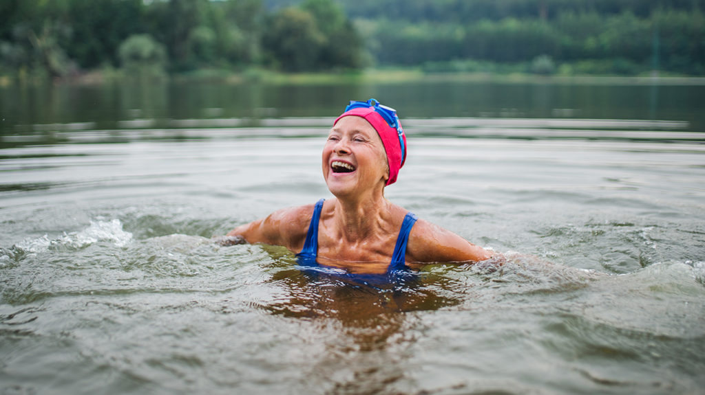 a senior woman having a swim and wondering how long does it take to lower blood pressure