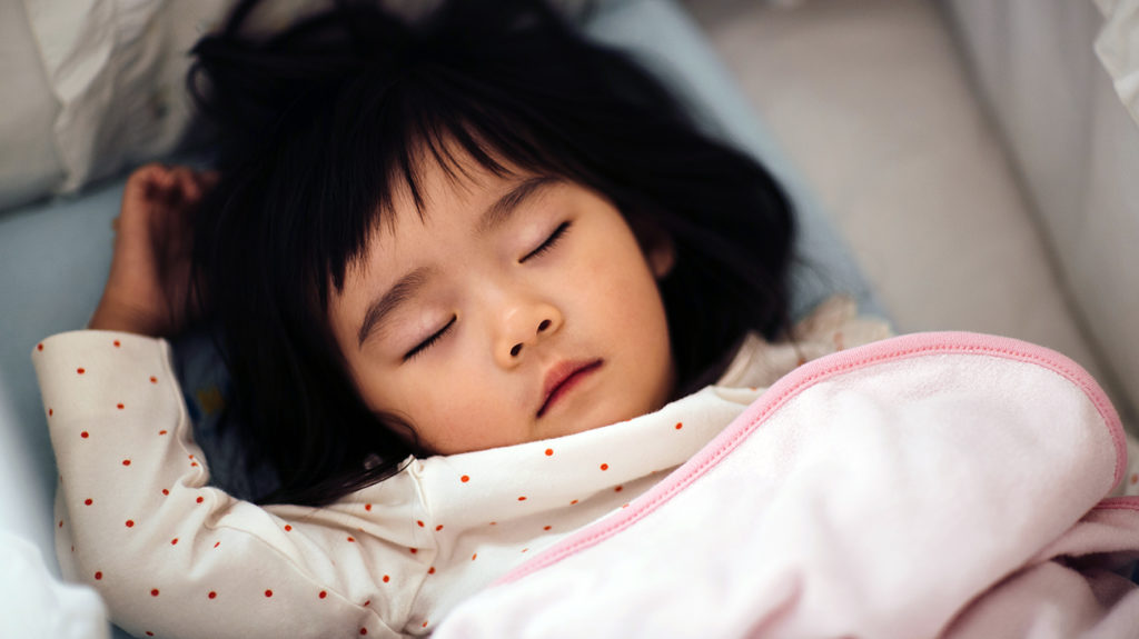 a toddler sleeping who is going through the 18 month sleep regression