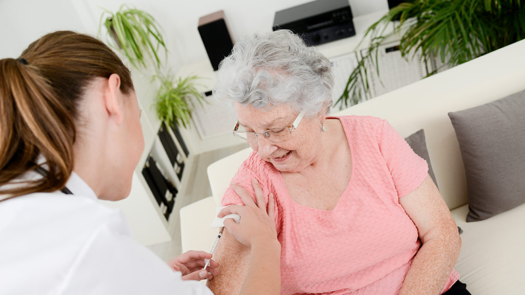 a woman getting a shingles vaccine which she does have cover for with medicare