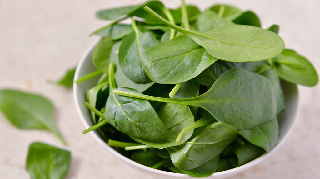 a bowl of spinach which is one of the Foods that are high in electrolytes