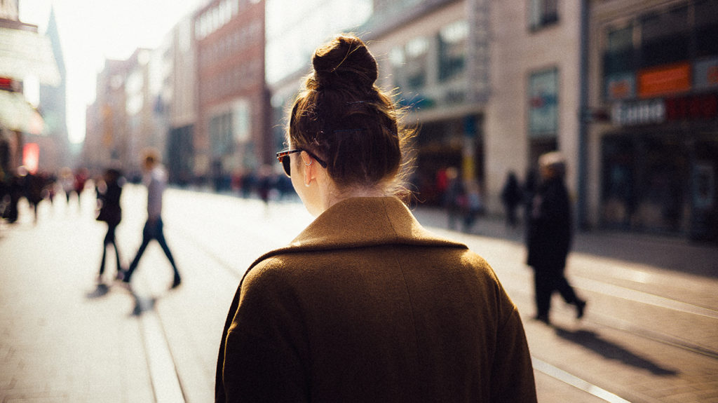 a woman with under active thyroid and depression walks the streets