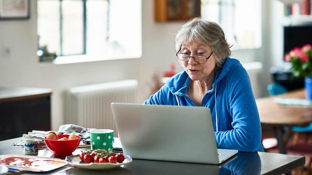 a woman on her laptop looking up when and how to change Medicare plans